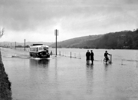 A bus drives through the flooded Carrigrohane Straight during the floods of 1937