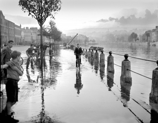 Children play in the floods at Lavitt's Quay in 1953.