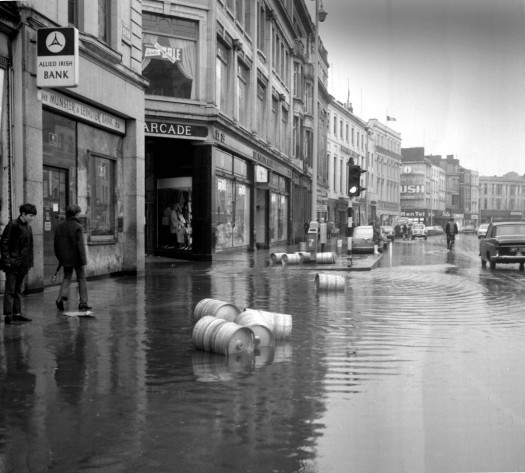 Boys watch beer kegs floating down Patrick Street in 1972
