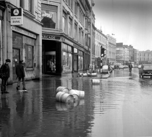 Boys watch beer kegs floating down Patrick Street in 1972