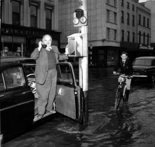Ringing for help in Patrick Street during the floods in St Patrick Street in 1961